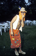 Man dressed in fancy dress beach gear, wearing straw hat and orange wig, Dance festival, UK 1990's,
