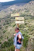 Woman walking in the the River Rio Poqueira gorge valley, High Alpujarras, Sierra Nevada, Granada Province, Spain