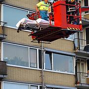 Vrouw gevallen van balkon Phohiflat Huizen