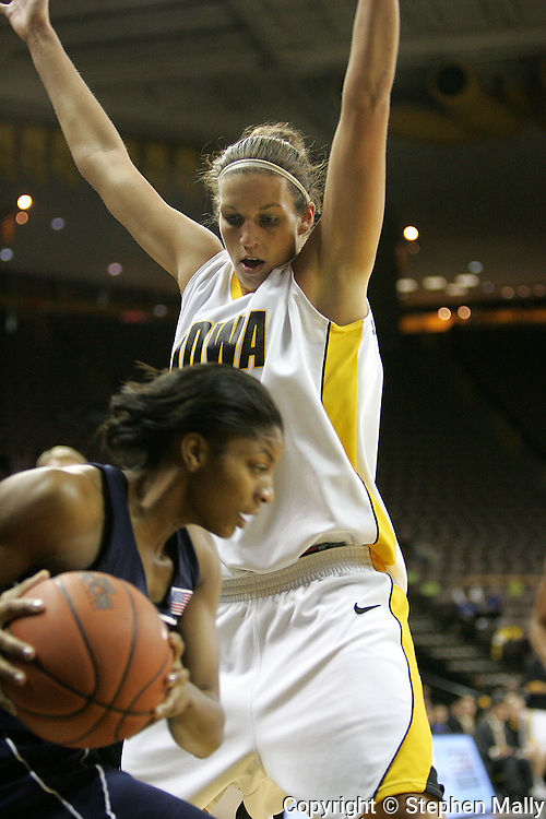 28 NOVEMBER 2007: Iowa forward Wendy Ausdemore (32) tries to block a pass by Georgia Tech guard Jacqua Williams (1) in the first half of Georgia Tech's 76-57 win over Iowa in the Big Ten/ACC Challenge at Carver-Hawkeye Arena in Iowa City, Iowa on November 28, 2007.