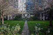 Hopton's Alms Houses, London SE1. Hopton's Almshouses were built in 1752 by trustees appointed under the will of Charles Hopton. 26 poor persons were chosen to occupy the houses. Almsmen were allowed to marry but the original rules were framed to prevent children of the almsmen becoming chargeable to Christ Church parish. Each almsman was to receive a chaldron of coals and a payment of not less than £6 a year. The almshouses consist of a continuous range of two-storey cottages on three sides of the central lawn with trees and paved paths.