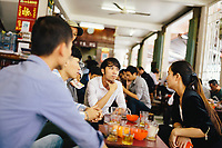 A group of young Vietnamese at a local coffee shop in Danang, Vietnam.