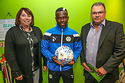 Forest Green Rovers Drissa Traoré(4) with the match ball sponsors during the EFL Sky Bet League 2 match between Forest Green Rovers and Swindon Town at the New Lawn, Forest Green, United Kingdom on 22 September 2017. Photo by Shane Healey.