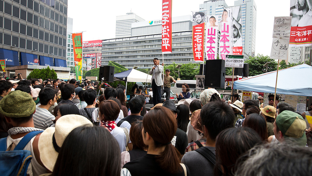 TOKYO, JAPAN - JULY 8 :  Yohei Miyake, Japanese musician and independent candidate for July's House of Councillors elections delivers his campaign speech during the Upper House election campaign outside of Shinjuku Station, Tokyo, Japan, on July 8, 2016. The July 10, 2016 Upper house election is the first nation-wide election in Japan after government law changes its voting age from 20 years old to 18 years old.  (Photo by Richard Atrero de Guzman/NUR Photo)