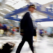 A pilot heads down the long United C concourse at O'Hare Airport in Chicago Friday afternoon August 3, 2001
