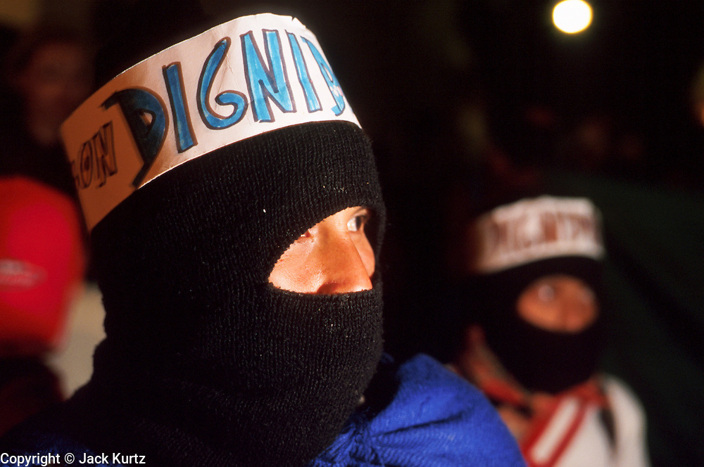 FEB 24, 2001 - SAN CRISTOBAL DE LAS CASAS, CHIAPAS, MEXICO: Members of  the EZLN (Zapatistas) march through San Cristobal de las Casas, Chiapas, Mexico, Feb. 24, 2001. The march was to mark the beginning of the Zapatista's caravan from San Cristobal de las Casas to Mexico City. About 3,000 Zapatistas participated in the march through San Cristobal. The Zapatistas went to Mexico City to press their demands for the passage of the San Andres Accords, signed between the Zapatistas and the Mexican government in 1996 but stalled in the Mexican congress by the formerly ruling Institutional Revolutionary Party.  © Jack Kurtz   INDIGENOUS  POVERTY    WOMEN   HUMAN RIGHTS    CIVIL RIGHTS    WAR  VIOLENCE
