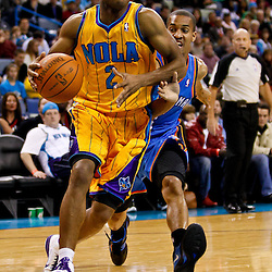 December 10, 2010; New Orleans, LA, USA; New Orleans Hornets point guard Jarrett Jack (2) drives past Oklahoma City Thunder guard Eric Maynor (6) during the second half at the New Orleans Arena.  The Thunder defeated the Hornets 97-92. Mandatory Credit: Derick E. Hingle-US PRESSWIRE