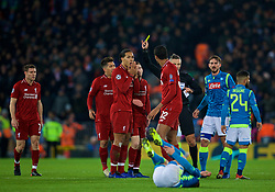 LIVERPOOL, ENGLAND - Tuesday, December 11, 2018: Liverpool's Virgil van Dijk (L) is shown a yellow card by referee Damir Skomina during the UEFA Champions League Group C match between Liverpool FC and SSC Napoli at Anfield. (Pic by David Rawcliffe/Propaganda)