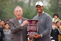 Tiger Woods of USA, left and Rory McIlroy of Northern Ireland speak during a television interview during the Duel at Jinsha Lake at the Golf Villa Jinsha Lake on October 29, 2012 in Zhengzhou, China. Photograph by David Paul Morris