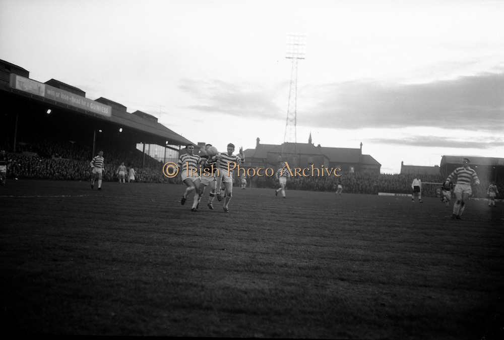 29/04/1964<br /> 04/29/1964<br /> 29 April 1964 <br /> F.A.I. Cup Final replay- Shamrock Rovers v Cork Celtic at Dalymount Park, Dublin. Rovers won the game 2-1.O'Donovan (Celtic) partly hidden by ball, is sandwiched by Rovers players ? and Johnny Fullam.
