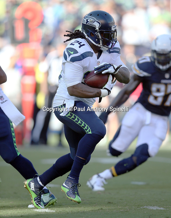 Seattle Seahawks running back Marshawn Lynch (24) runs the ball in the first quarter during the 2015 NFL preseason football game against the San Diego Chargers on Saturday, Aug. 29, 2015 in San Diego. The Seahawks won the game 16-15. (©Paul Anthony Spinelli)