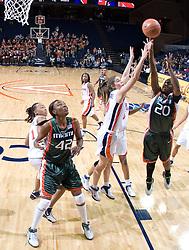 Miami Hurricanes guard Albrey Grimsley (20)shoots over Virginia Cavaliers Guard Brenna McGuire (10).  The University of Virginia Cavaliers defeated the Miami Hurricanes Women's Basketball Team 73-60 at the John Paul Jones Arena in Charlottesville, VA on February 4, 2007.