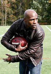 "October 8, 2009; Florham Park, NJ; USA; Floyd ""Money"" Mayweather strikes his running back pose after the New York Jets practice in Florham Park, NJ."