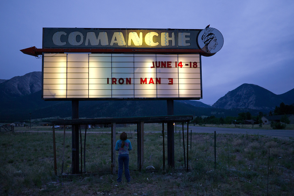 The Comanche Drive-In Theater is one of seven vintage theaters in the state of Colorado. Owned and operated by the Groy family in Buena Vista, Colorado, The Comanche has been in operation off and on for the past 47 years. The Groys still project their films on traditional 35mm Simplex Projectors using a carbon arc lamphouse. The family purchased the 1950's equipment from a  theater in Montrose, Colorado and opened for business in 1966. Four generations of the Groy family have helped to shape this nostalgic experience, operating the drive-in cinema in the small Colorado mountain town through the years.
