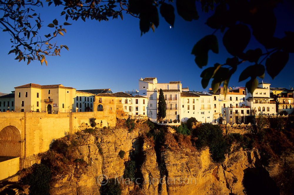 View of cliffs & houses in Ronda at sunset, Andalucia, Spain