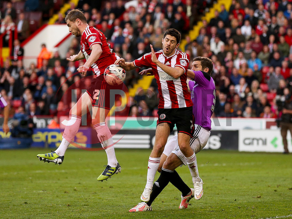 Louis Reed of Sheffield United challenges Sam Ricketts of Swindon Town  - Photo mandatory by-line: Matt McNulty/JMP - Mobile: 07966 386802 - 07/05/2015 - SPORT - Football - Sheffield - Bramall Lane - Sheffield United v Swindon Town - Sky Bet League One
