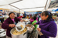 Pisac, Peru - July 14, 2013: Women cooking at Pisac market in the peruvian Andes at Pisac Peru on july 14th 2013