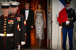United States President Donald J. Trump and first lady of the United States Melania Trump emerge from the White House as the await the arrival of French President Emmanuel Macron and first lady of France Brigette Macron prior to the State Dinner during the French State Visit to the United States on April 24, 2018 in Washington, DC. Credit: Alex Edelman / Pool via CNP