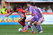 Exeter City's Ollie Watkins is fouled by Plymouth Argyle's Jordan Houghton during the Sky Bet League 2 match between Exeter City and Plymouth Argyle at St James' Park, Exeter, England on 2 April 2016. Photo by Graham Hunt.