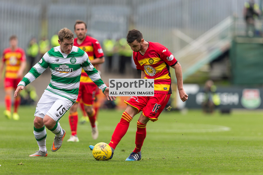 David Wilson is chased by Kris Commons during the Scottish Premiership match between Partick Thistle and Celtic (c) ROSS EAGLESHAM | Sportpix.co.uk