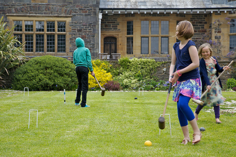 Playing croquet in the garden at Pickwell Manor. From left to right: Zac Baker (11), Liza Baker (9), Millie-grace Elliott (8). Pickwell Manor, Georgeham, North Devon, UK.<br /> CREDIT: Vanessa Berberian for The Wall Street Journal<br /> HOUSESHARE