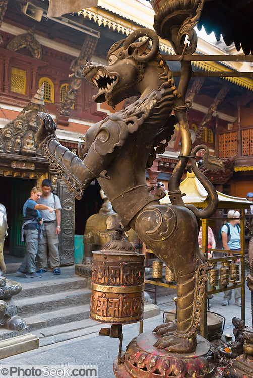 "A fierce dragon horse sculpture stands proudly at Golden Temple (Hiranya Varna, or Suwarna Mahavihara), a Buddhist Monastery existing since 1409 or earlier, located just north of Patan's Durbar Square, in Nepal, Asia. Patan was probably founded by King Veer Deva in 299 AD from a much older settlement. Patan, officially called Lalitpur, the oldest city in the Kathmandu Valley, is separated from Kathmandu and Bhaktapur by rivers. Patan (population 190,000 in 2006) is the fourth largest city of Nepal, after Kathmandu, Biratnagar and Pokhara. The Newar people, the earliest known natives of the Kathmandu Valley, call Patan by the name ""Yala""  (from King Yalamber) in their Nepal Bhasa language. UNESCO honored Patan's Durbar Square (Palace Square) as one of the seven monument zones of Kathmandu Valley on their World Heritage List in 1979. All sites are protected under Nepal's Monuments Preservation Act of 1956."