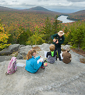 A group of middle school students at Owl's Head Mountain prepare for their prsentations about Kettle Pond's geology.