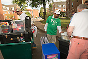 Ohio University President Roderick McDavis (Right) and volunteer Nick Downing (Left) help first year students move into their residence halls on East Green. Photo by Ben Siegel
