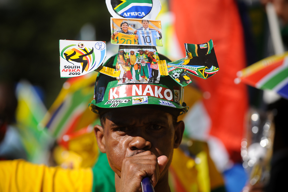 "South Africans celebrate at the ""United We Shall Stand"" rally for the South African national soccer team, Bafana Bafana, Tuesday, June 9, 2010 in Johannesburg, South Africa. South Africa is hosting the FIFA World Cup, which begins June 11. Photo by Bahram Mark Sobhani"