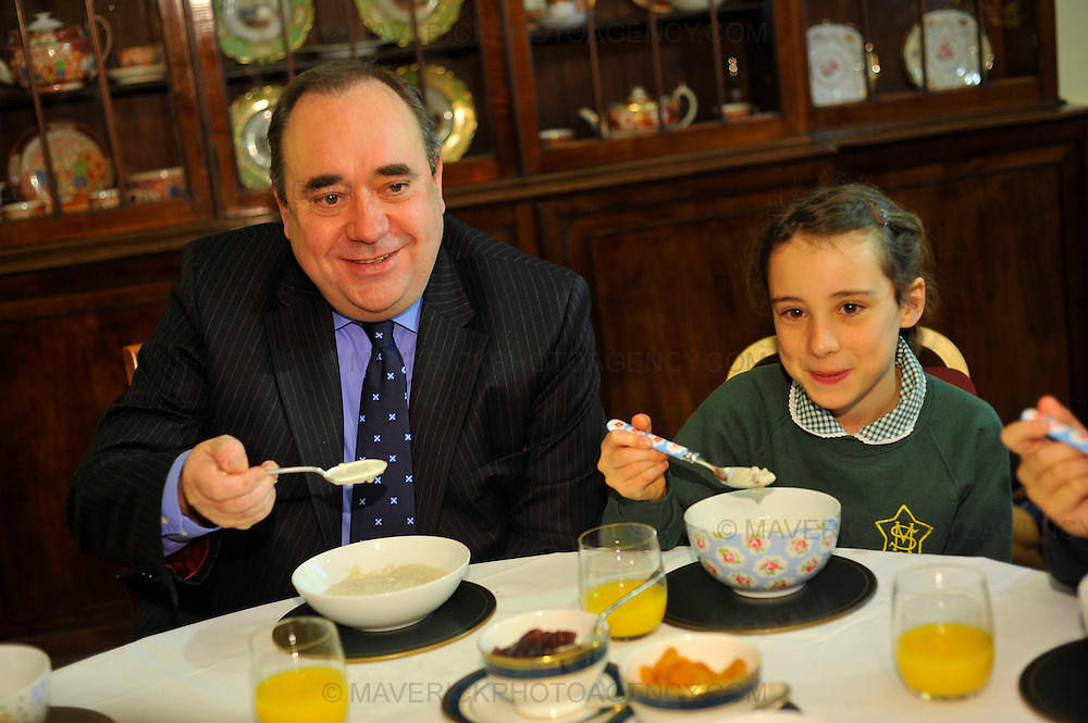 EDINBURGH, UK - 6th October 2010: Two pupils from St Mary's Primary School in Edinburgh and five pupils from Dalmally Primary School in Argyll joined First Minister Alex Salmond for porridge during breakfast at Bute House to mark world Porridge Day.  World Porridge Day is expected to raise thousands of pounds for the charity Mary's Meals and takes place this Sunday.  Pictured Alex Salmond with Eve Woehrling age 8 from St Mary's Primary School.(Photograph: Callum Bennetts/MAVERICK)