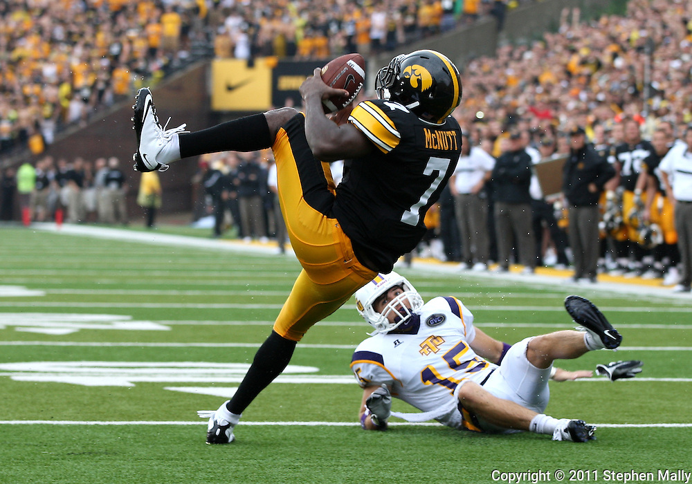 September 3, 2011: Iowa Hawkeyes wide receiver Marvin McNutt (7) pulls in a pass as Tennessee Tech Golden Eagles cornerback Caleb Mitchell (15) looks on during the first half of the game between the Tennessee Tech Golden Eagles and the Iowa Hawkeyes at Kinnick Stadium in Iowa City, Iowa on Saturday, September 3, 2011. Iowa defeated Tennessee Tech 34-7 in a game stopped at one point due to lightning and rain.