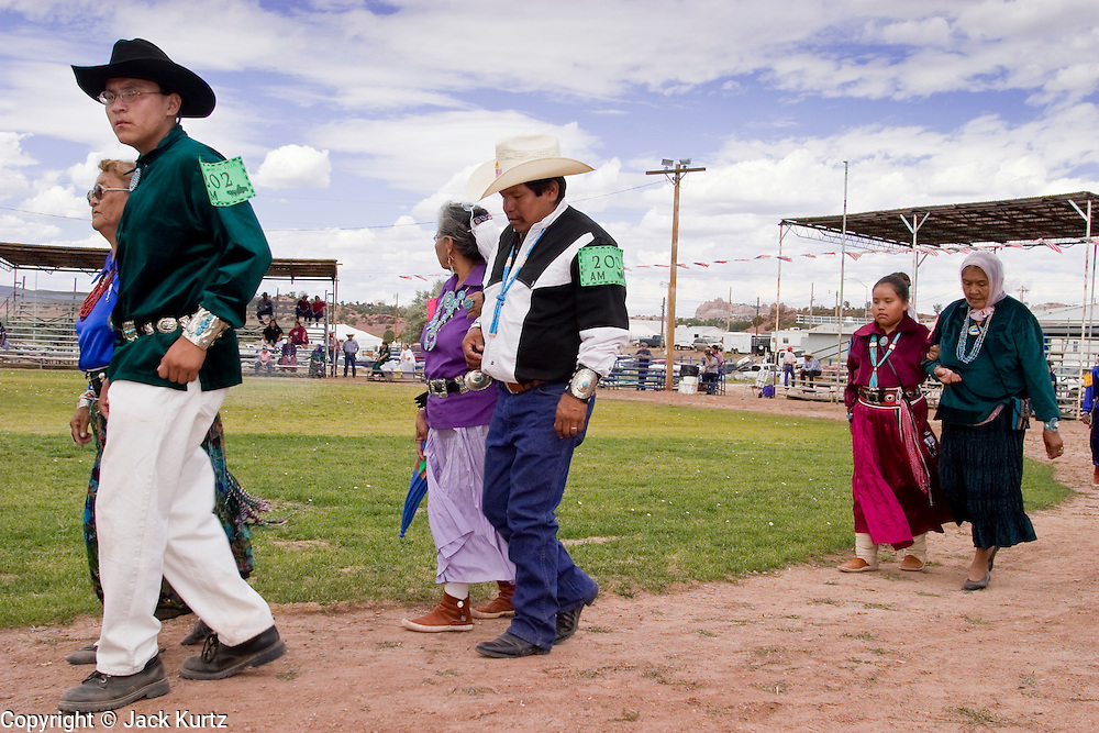 10 SEPTEMBER 2004 - WINDOW ROCK, AZ: A traditional Navajo song and dance during the 58th annual Navajo Nation Fair in Window Rock, AZ. The Navajo Nation Fair is the largest annual event in Window Rock, the capitol of the Navajo Nation, the largest Indian reservation in the US. The Navajo Nation Fair is one of the largest Native American events in the United States and features traditional Navajo events, like fry bread making contests, pow-wows and an all Indian rodeo. Traditional Navajo song and dance competitions are not as flashy as pow-wows and they are not as fast paced as the larger inter tribal pow-wows that take place during the fair.  PHOTO BY JACK KURTZ
