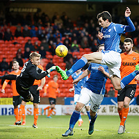Dundee United v St Johnstone....21.11.15  SPFL,  Tannadice, Dundee<br /> Joe Shaughnessy gets to the ball ahead of Micahl Szromnik<br /> Picture by Graeme Hart.<br /> Copyright Perthshire Picture Agency<br /> Tel: 01738 623350  Mobile: 07990 594431