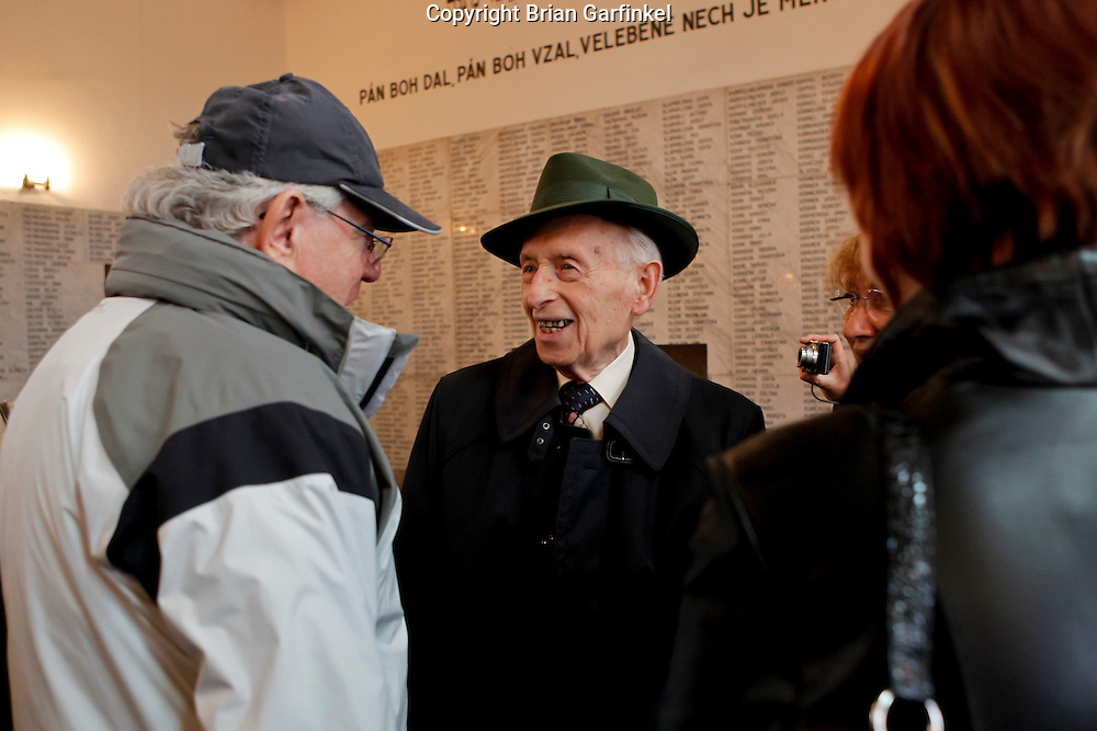 Palo speaks with a friend after a memorial service at the Jewish cemetery in Zilina, Slovakia on Sunday July 3rd 2011. (Photo by Brian Garfinkel)