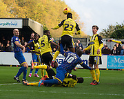 Goalmouth action during the Sky Bet League 2 match between AFC Wimbledon and Dagenham and Redbridge at the Cherry Red Records Stadium, Kingston, England on 15 November 2014.