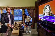 28 AUGUST 2012 - MESA, AZ: Rep. JEFF FLAKE (R-AZ) adjusts his TV set in his Mesa, AZ, home while LUCE VELO FORTUNO speaks at the Republican National Convention in Tampa, FL, on the night of Arizona's primary election. Flake is the incumbent Congressman from Arizona's 6th Congressional District. He won the Republican primary for the US Senate seat being vacated by retiring Senator Jon Kyl. Flake faced Arizona businessman and political newcomers Wil Cardon in the primary and won handily.     PHOTO BY JACK KURTZ