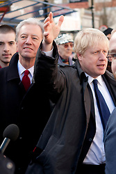 © Licensed to London News Pictures. 08/03/2012. London, UK. Mayor of London Boris Johnson (left) with Marcus Aigus (Right, Chairman of Barclays) pictured in the Roman Road Market in Bow today (08/03) to publicise the eastern extension of the Barclays Bike cycle hire scheme which launches today. Photo credit : James Gourley/LNP