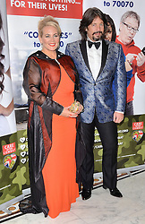 Jackie Bowen and Laurence Llewelyn-Bowen  attend The Care After Combat Inaugural Ball at The Dorchester Hotel, Park Lane, London on the Tuesday 31st March 2015