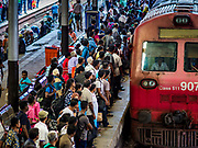 07 OCTOBER 2017 - COLOMBO, SRI LANKA: Passengers line up to board an incoming train at the Fort Station in Colombo. The Fort Station is Colombo's main train station and serves as the hub of Sri Lanka's train system. The station opened in 1917 and is modeled after Manchester Victoria Station.    PHOTO BY JACK KURTZ