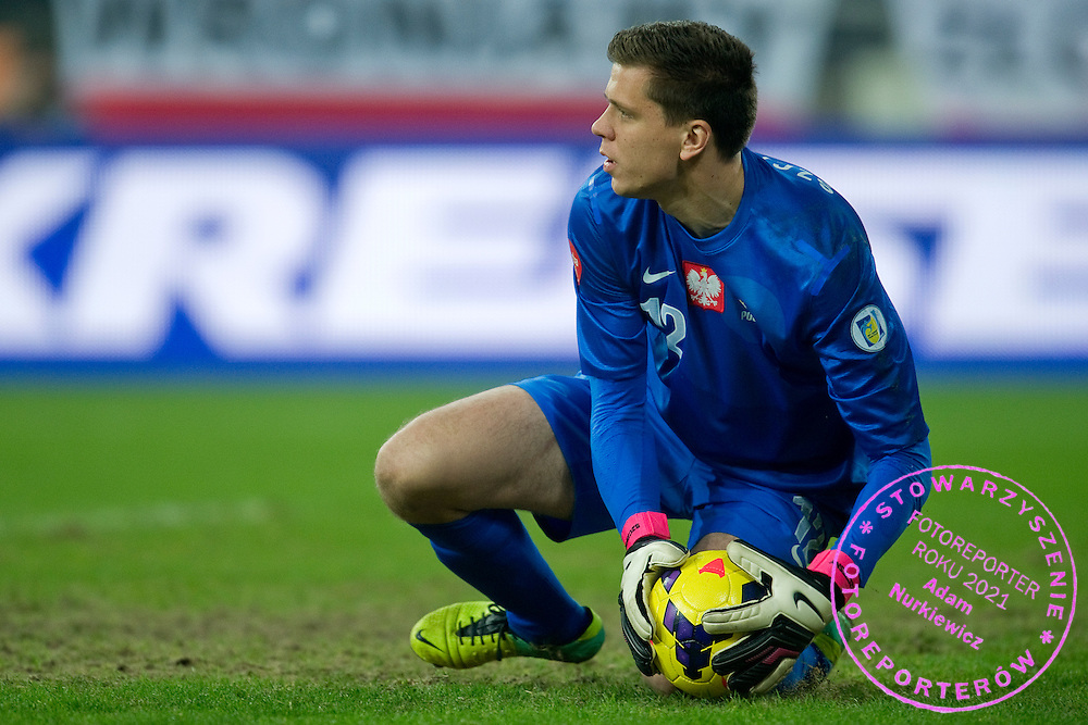 pwosPoland's goalkeeper Wojciech Szczesny controls the ball during international friendly soccer match between Poland and Ireland at Inea Stadium in Poznan on November 19, 2013.<br /> <br /> Poland, Poznan, November 19, 2013<br /> <br /> Picture also available in RAW (NEF) or TIFF format on special request.<br /> <br /> For editorial use only. Any commercial or promotional use requires permission.<br /> <br /> Mandatory credit:<br /> Photo by © Adam Nurkiewicz / Mediasport