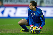 pwosPoland's goalkeeper Wojciech Szczesny controls the ball during international friendly soccer match between Poland and Ireland at Inea Stadium in Poznan on November 19, 2013.<br /> <br /> Poland, Poznan, November 19, 2013<br /> <br /> Picture also available in RAW (NEF) or TIFF format on special request.<br /> <br /> For editorial use only. Any commercial or promotional use requires permission.<br /> <br /> Mandatory credit:<br /> Photo by &copy; Adam Nurkiewicz / Mediasport