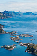 Above the Arctic Circle, ascend a slippery steep trail to Reinebringen for views of the town of Reine, highway E10 bridges over Reinefjord, Moskenesøya (the Moskenes Island), and the Lofoten archipelago, in Nordland county, Norway.