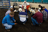 "A chaplain leads riders and crew in a ""cowboy prayer"" before the start of the PBR rodeo at the Del Mar Fairgrounds in Del Mar, California on July 26th, 2008."
