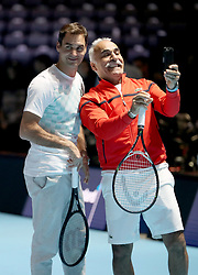Mansour Bahrami takes a selfie with Roger Federer on court ahead of the Andy Murray Live Event at the SSE Hydro, Glasgow.
