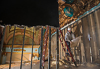 "Renovation work done by Bonnette, Page and Stone at the Colonial Theater in downtown Laconia.  Bob Ferguson works carefully to uncover the centerpiece of the upper stage revealing the year ""1914"".  ©2016 Karen Bobotas Photographer"