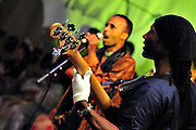 """Bass player Youba Dia playing with Nabil Othmani during the """"III Rencontre Internationale d'Imzad"""", Tamanrasset."""