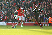 Arsenal striker, Danny Welbeck (23) with a shot on goal during the The FA Cup Quarter Final match between Arsenal and Watford at the Emirates Stadium, London, England on 13 March 2016. Photo by Matthew Redman.