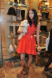 KRISTIN KNOX and her dog Butters at a party to celebrate the opening of the new UGG Australia Flagship store at 5-7 Brompton Road, London on 2nd November 2011.