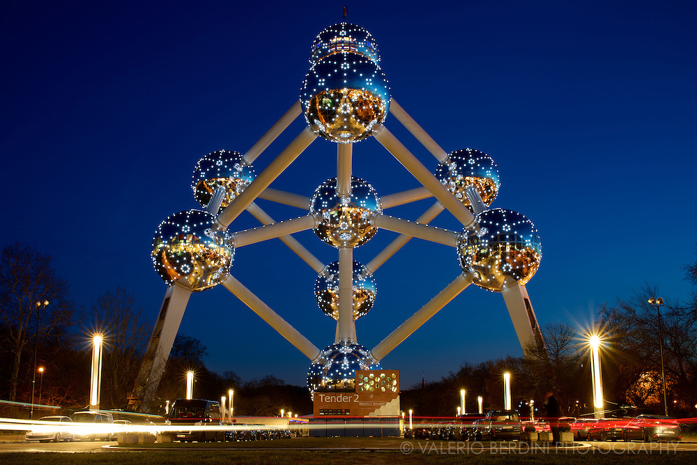 The Atomium is a building in Brussels originally constructed for Expo '58, the 1958 Brussels World's Fair. Designed by the engineer André Waterkeyn and architects André and Jean Polak, it stands 102 m (335 ft) tall. Its nine 18 m (59 ft) diameter stainless steel clad spheres are connected so that the whole forms the shape of a unit cell of an iron crystal magnified 165 billion times. Brussels, Belgium. 2014