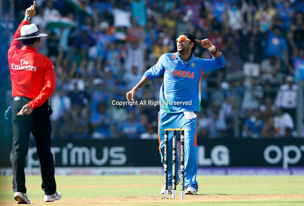 02.04.2011 Cricket World Cup Final from the Wankhede Stadium in Mumbai. Sri Lanka v India. Yuvraj Singh of India celebrates the wicket of Sri Lankan Captian Kumar Sangakkara during the final match of the ICC Cricket World Cup between India and Sri Lanka on the 2nd April 2011